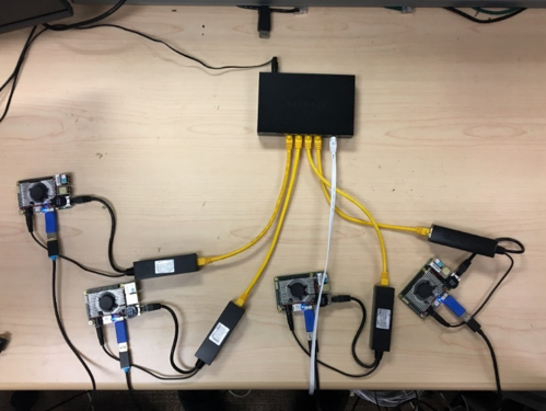 Figure 10. Configuration of 4 UP Boards connected to 4 Intel RealSense cameras, and powered by directly over the ethernet connection.
