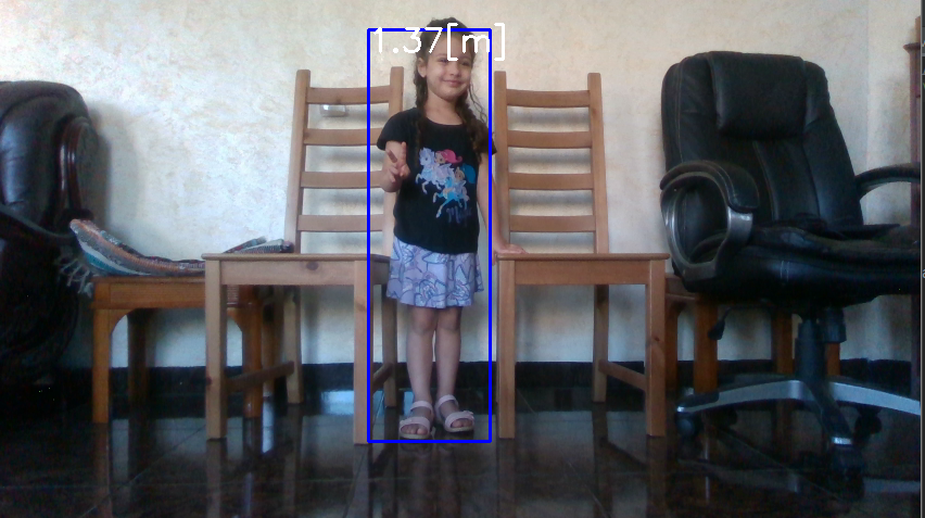 Example 2: Image of a small child with a bounding box showing approximated height.
