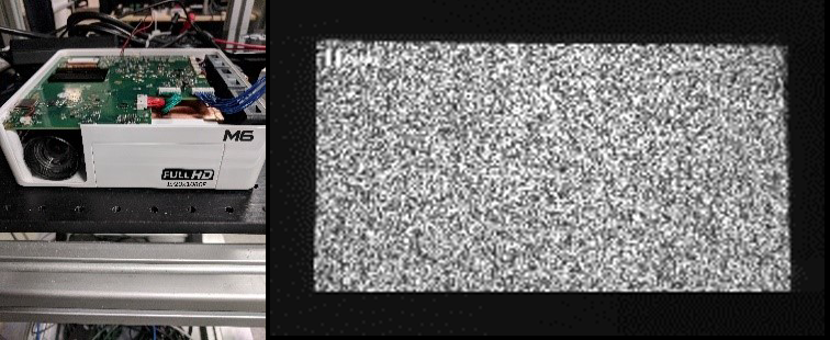 Figure 10. A conventional visible projector (Left) used to project the pattern projected (Right image) onto a white wall. The measured RMS error was about ~0.04 pixels.