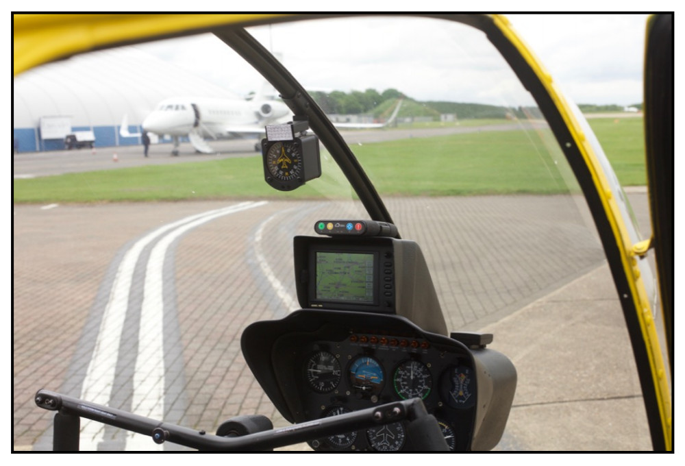 RockAIR in Helicopter - An example of a good mounting position in a helicopter, showing a clear view of the sky through the windshield.