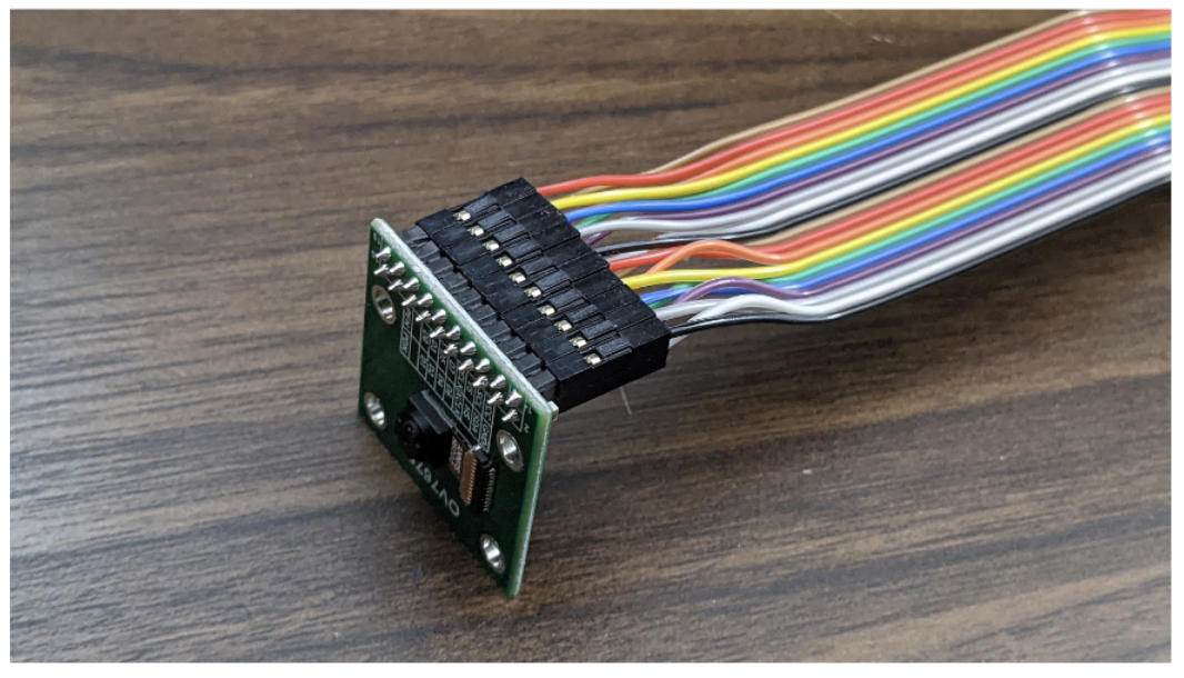OV7675 camera module with female headers connected.