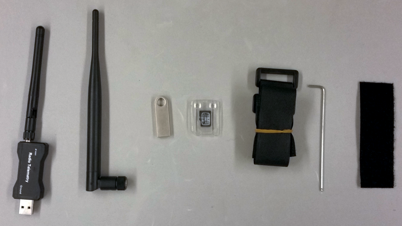 Left to right: USB Telemetry Unit; Airframe Telemetry Antenna; USB Drive with Manuals; SD Card - preloaded with flight firmware; 2 Velcro® straps; 1 Allen Wrench; 1 half of one section of self-adhesive Velcro ®