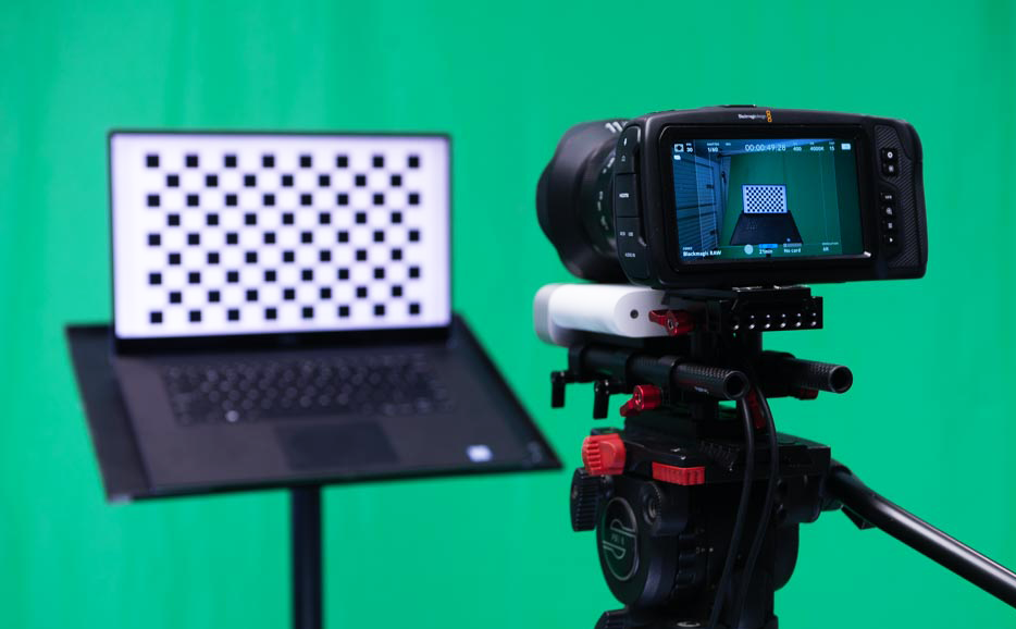The screen is a few feet in front of the camera, oriented to face the camera.