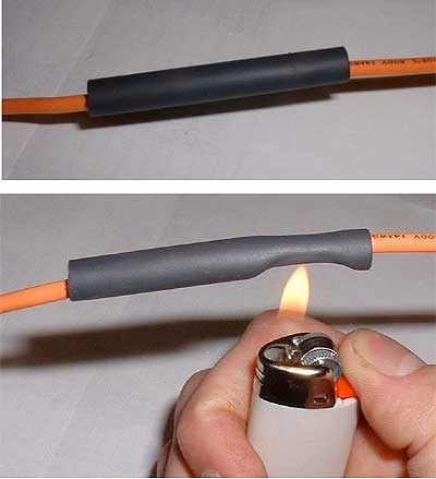 Heating of heat-shrink tubes. Notice how it wraps around the wire once heated.
